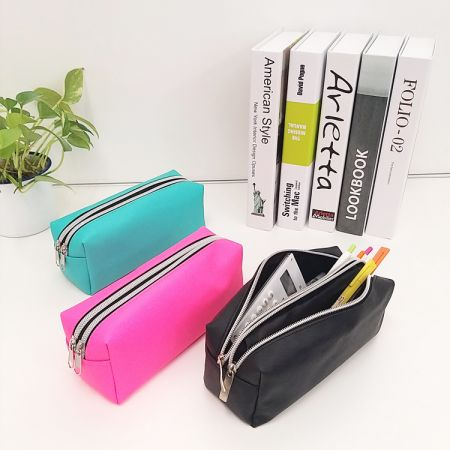 PVC Large Pencil Case - The PVC large capacity pencil case has two compartments with a zipper and offers space for 60-80 pens. It's convenient to put in the backpacks when heading for school or office.