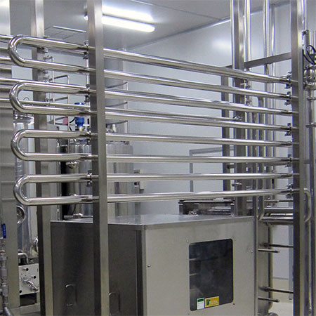 Holding Tubes - Non-sloped stainless steel holding tubes in HTST pasteurization system.