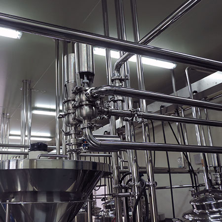 Sanitary Process Piping - Stainless steel process piping with automatic air-operated seat valves.