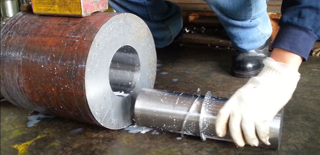 Ju Feng provides steel-drilling services for customers.