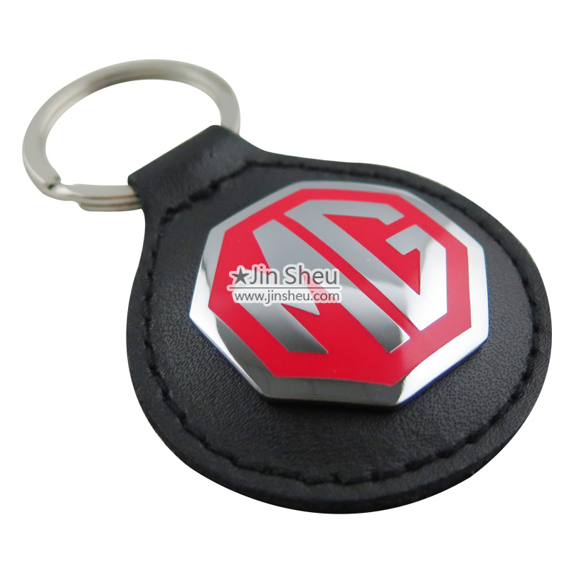 Austin Keyring Key Ring badge mounted on a leather fob