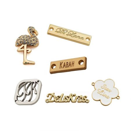 metal tags with rhinestones, enamels and cutouts