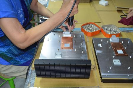 Assembling industrial computer chassis.