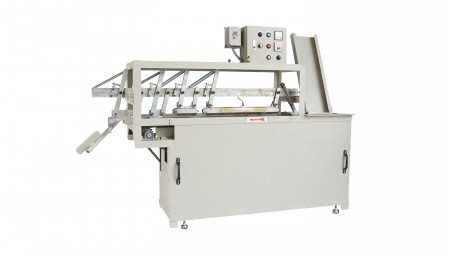 Bobbin Yarn Cutter - The machine can cut waste yarn in bobbins automatically.