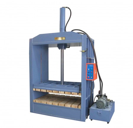 Hydraulic Baling Press - Pressing finished woven Mats into solid bundles.