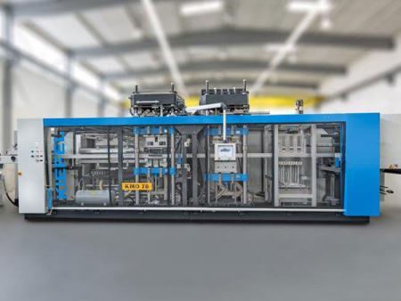 Máy định hình áp suất tự động hộp nhựa cấp thực phẩm.