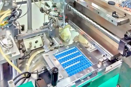 Máquina automática de inserción de PIN.