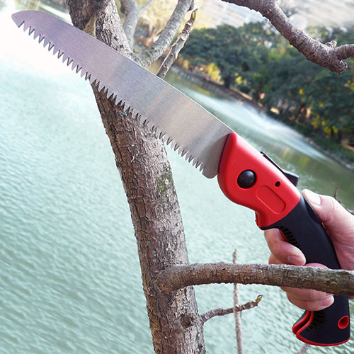 Hand-held Folding Saw for Cutting Through Dry and Green Wood