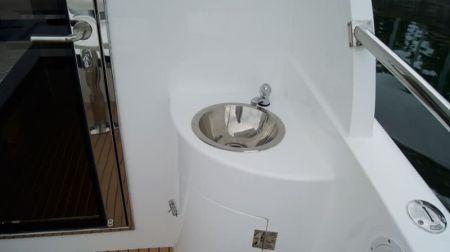 Sunshine-32-foot enclosed wheelhouse yacht the washbasin