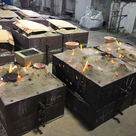 Pouring into each sand casting mold