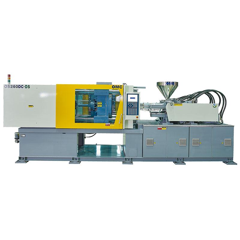 Dual color injection molding machine with Toshiba servo motor.
