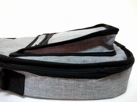 Collapsible front zipper pocket.