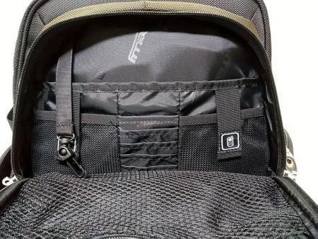 Upper front zipper pocket.