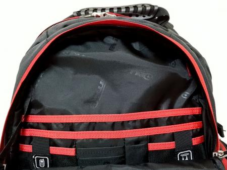 Inside the front zipper pocket.