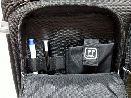 Front left pocket's pen and phone pockets.