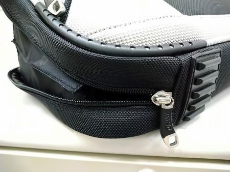 Main compartment's zipper can be unzipped all the way to the bottom to open the main compartment to the fullest.