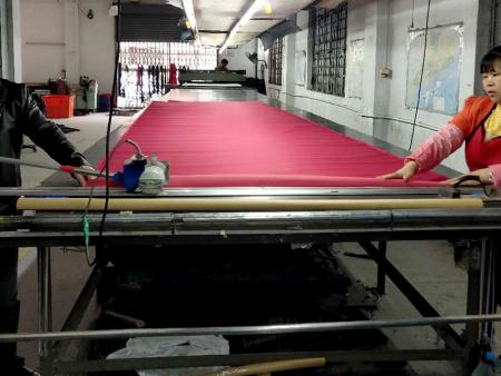 Cutting Department - Roll of fabric cut with the required specifications to the production line.