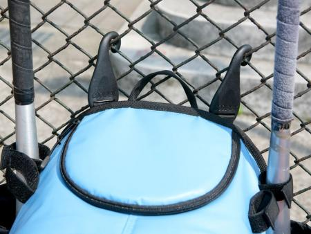 Plastic hooks to hang the bag on the fence.
