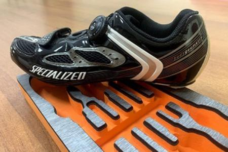 Cycling shoes made by our mid sole and tool box with decoration.