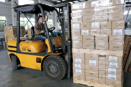 Inventory staff is organizing goods before shipment.