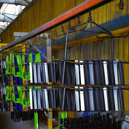 All of powder coated parts go through the powder coating line in the factory.
