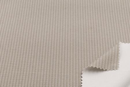 Tejido de membrana impermeable de base biológica para uso en forros de calzado.