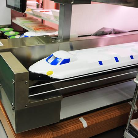 The High Speed Sushi Train in the kitchen of Kintarosumoto Sushi.