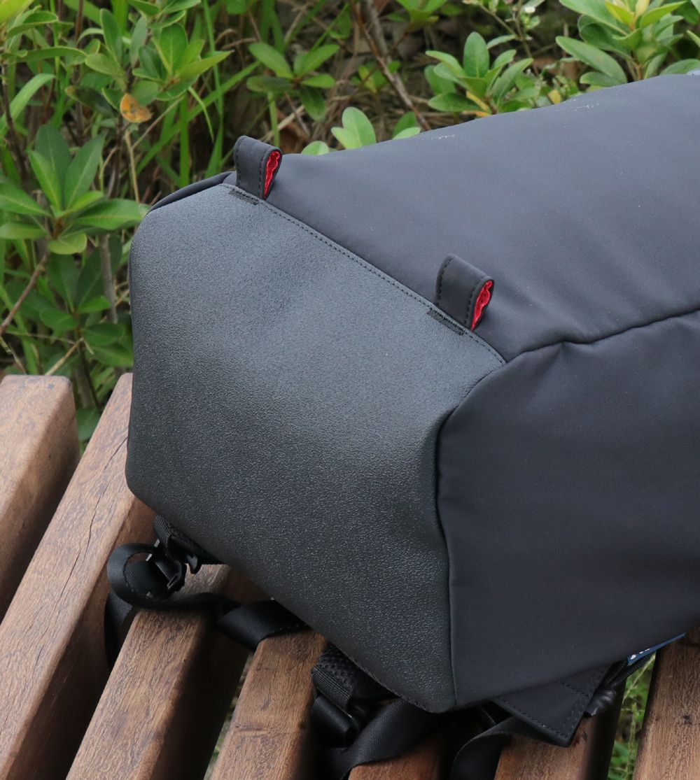 Niche backpack with durable abrasive bottom material