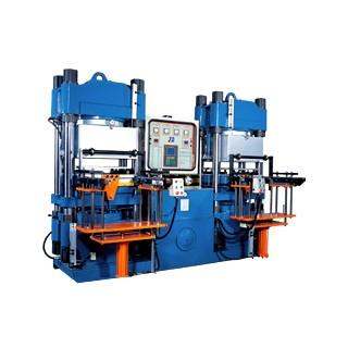 Macchina per lo stampaggio a compressione sottovuoto