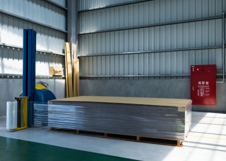 Wood pallet place with drier and cover with PE Film by auto wrapping machine