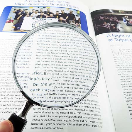 Hand held magnifying glass for reading