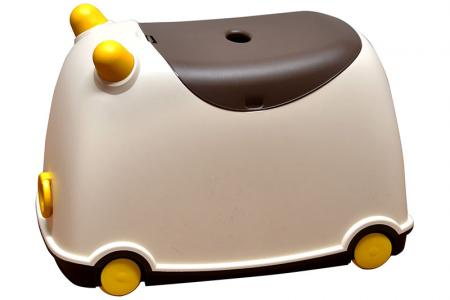 Tow-along BuBu moveable toy storage bin for children in brown.