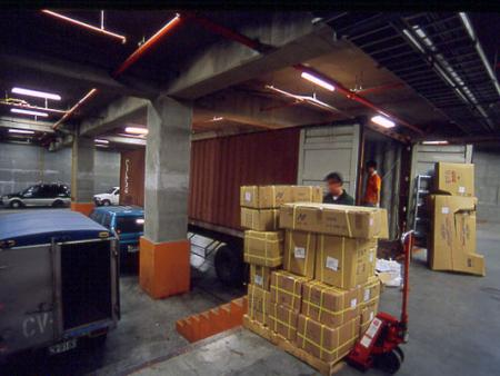 Loading goods into the container.