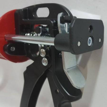 Caulking gun thumb pressure release