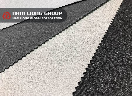 回收橡膠海綿耐磨布 - 聚酯平織布上佈以回收橡膠海綿碎粒以達耐磨效果