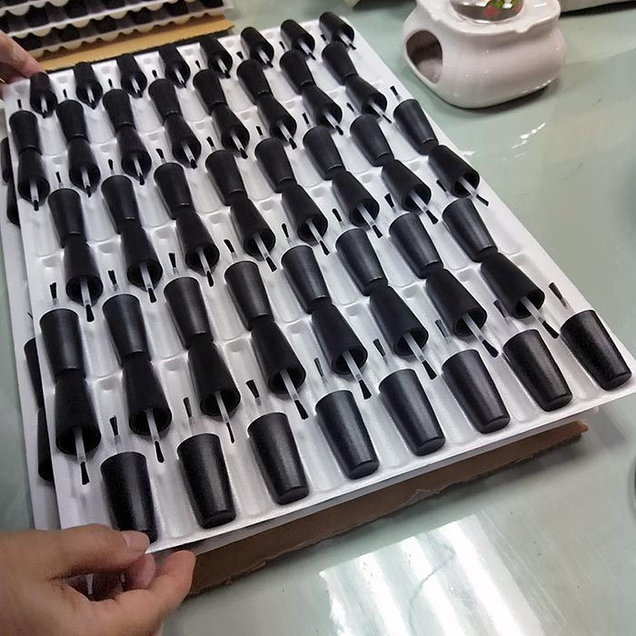 Assembled caps & brushes on trays