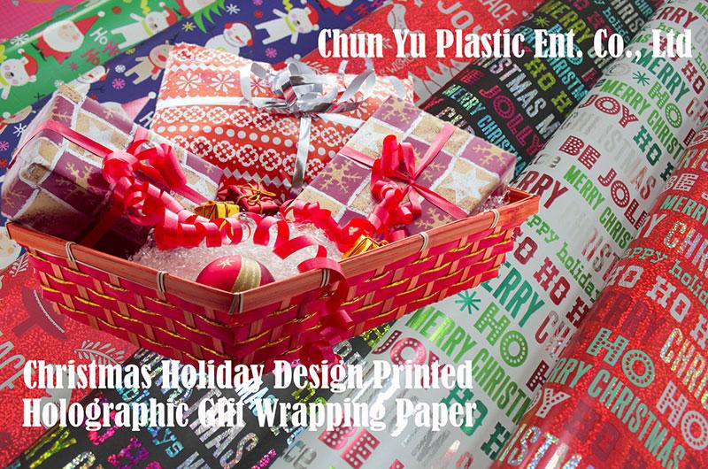 Kertas pembungkus kado dengan desain Natal dicetak untuk musim liburan.
