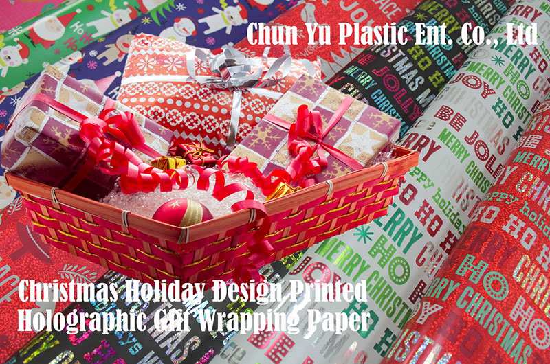 Gift wrapping paper with Christmas designs printed for holiday season.