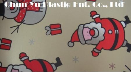 Metallic gift wrapping paper printed with Santa & Snowman designs for Christmas season