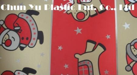 Metallic gift wrapping paper printed with Santa & Reindeer designs for Christmas season