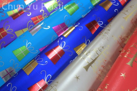 Metallic gift wrapping paper with Christmas design printed