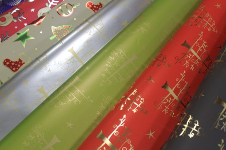 Metallic gift wrapping paper with design printed for Christmas holidays