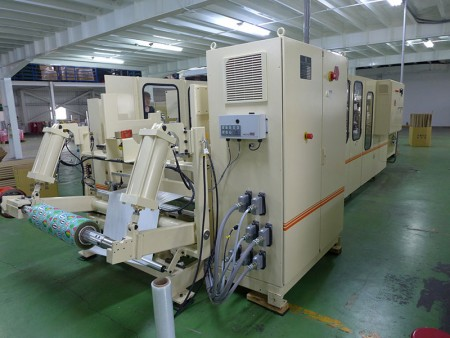 Fully automatic converting machine to make small roll of gift wrapping paper.