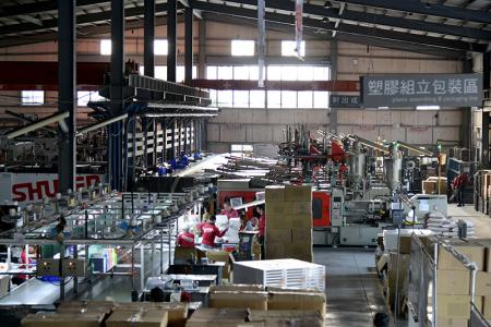 Assembly and packing line for plastic products.