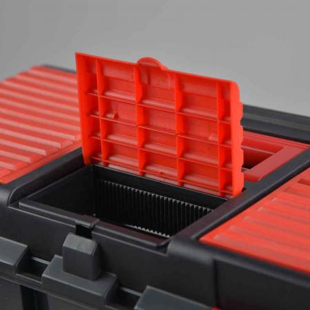 Top-entry storage compartment in the lid.
