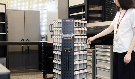 Revolving tower saves space and facilitates easy parts management.