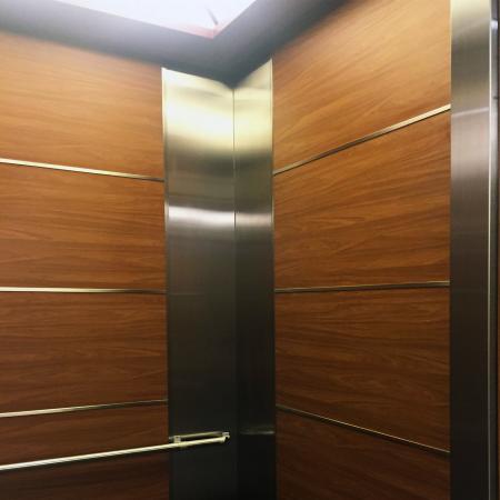 Wood Grain PVC Pre-coated Metal -Walnut (Walnut Wood Grain PVC Pre-painted steel passenger lift car indoor door sheet)