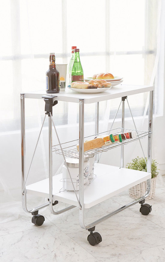 The folding serving cart is equipped with casters to assist in product mobility