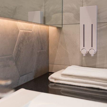 Shower dispenser installed in restroom
