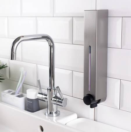 Shower dispenser installed above wash basin